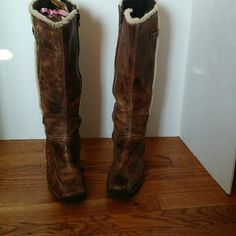 Fur-lined leather wedge boots Italian made leather boots with fur accent and man made fur lining in brown. Leather is a mottled brown and the leather has a rugged feel to it. It's a stiffer leather. Shoes Winter & Rain Boots