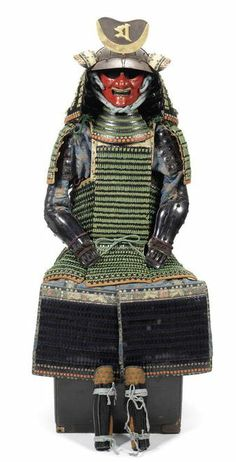 Female samurai Armor!   This armour was designed for a small women of less than five feet.  The mask was carved with a moustache and snarling teeth to disguise the fact that the wearer was a woman.  It is made of copper, iron and leather.  It's different from male samurai armour in that it is designed more like kimono so a woman could dress herself, preserving her modesty.