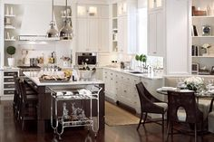 reminds me of my kitchen.  i like addition of the round table and bar cart.