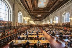 the General Research Room of the New York Public Library. Built in 1911, the library is located in midtown Manhattan on Fifth Avenue, between 40th and 42nd streets.