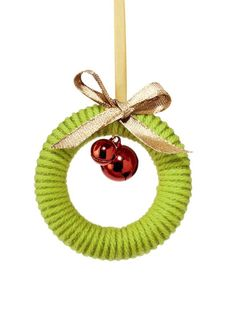 Mini Yarn Wreath Wind two pieces of yarn in different colors around a wood curtain ring. We used Bonbons yarn in lime from the Brights set a...