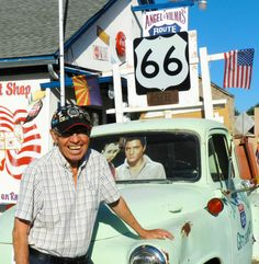 Angel resting on his truck outside of his barber shop on Route 66