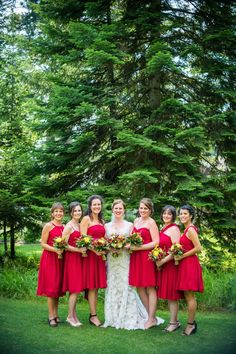 These ladies in red are TDF.    #brideside #realwedding #wedding #red #bridesmaids #maids #rustic #vintage  Vintage lace and wildflowers completed this Montana wedding | Brideside