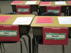 File folders on desks. Students can put finished work in these, plus no one will be messing with name tags on their desks.
