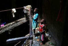 Children look at their neighbours in a building earmarked for demolition in the Mathare neighbourhoo... - Goran Tomasevic/Reuters