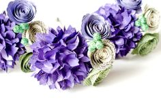 Mini bouquets (toss, bridesmaid or flower girl) in purples and greens, all made from the novels of Jane Austen