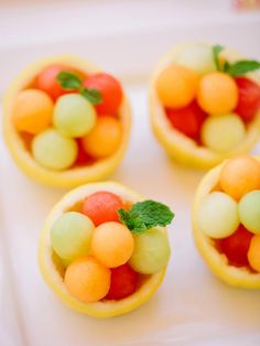 To make these adorable fruit cups, cut lemons to make small bowls, fill with fresh fruit and garnish with a sprig of mint. They make the perfect accompaniment to brunch or any party menu. Dessert Cups, Dessert Recipes, Spa Food, Fruit Appetizers, Citrus Recipes, Fruit Cups, Fruit Bowls, Baby Shower Desserts, Baby Shower Fruit