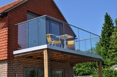 Semi frameless glass balcony installed in Hampshire