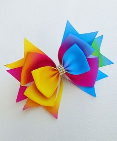 Take a look at this Light Blue & Yellow Rainbow Hair Bow today!