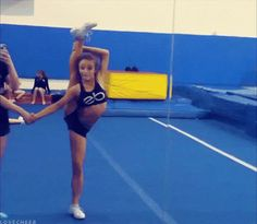 cheerleader cheerleading flexible what is this i don't even splits gif gymnast gymnastics