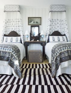 A bold Persian kilim is paired with Indian textiles in a bedroom of a South Carolina beach house