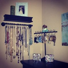 Super easy DIY necklace organization. Towel rack, shower hooks, small shelf. Now I can see all my necklaces and easily pick out/ put back them back!
