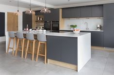 Create a modern scandi kitchen design by using a dark grey and wood effect cabinets in your kitchen. The perfect light and bright kitchen with large kitchen island. Open Plan Kitchen Dining Living, Kitchen On A Budget, Living Room Kitchen, Space Kitchen, David's Kitchen, Kitchen Ideas, Kitchen Decor, Kitchen Cupboard, Kitchen Layout