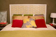This incredible West Elm inspired Moroccan headboard was made using four rubber door mats, painted plywood, and trim.