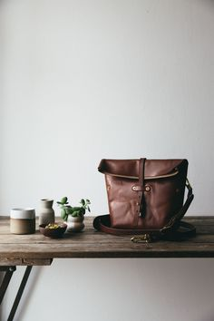 Oak Bark tanned leather Roam camera bag that will age beautifully, and become full of character on your travels. Equally useful as an everyday cross body bag, this camera bag will fit the basic essentials you need when out capturing the city or the wilderness. This leather comes from the last remaining Oak Bark tannery in the UK who choose the best local hides and treat them in a sustainable process using natural products