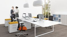 large shared office - worktable with multiple casual work stations Corporate Office Design, Office Furniture, Office Desk, Furniture Design, Office Spaces, Shared Office, Hanging Rail, Desk Storage, Extension