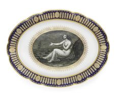 A rare Flight Worcester platter from the 'Hope' service, circa 1790 Made for the Duke of Clarence, the centre finely painted in monochrome by John Pennington with a seated figure of Hope gesturing towards a ship in full sail in the distance, an anchor at her feet, surrounded by an elaborate gilded formal band, the shaped border gilt with paterae and arched panels reserved on a blue ground gilt with stars, 48cm wide, crown, Flight and crescent mark in blue Footnotes John Flight recorded in…