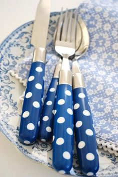 love the pale blue, floral patterns with the whimsical polka dots on dark blue handles...