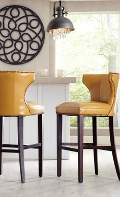 Graceful styling and handsome nailhead trim make our shapely Morgan Stool look as spectacular as she sits.