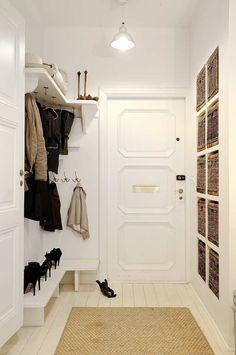 Beautiful, organized entry hallway with hooks, shelves and shoe storage.