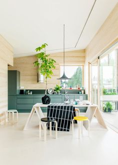 Pretty modern green kitchen with natural wood walls // modern Scandinavian vibe going on here
