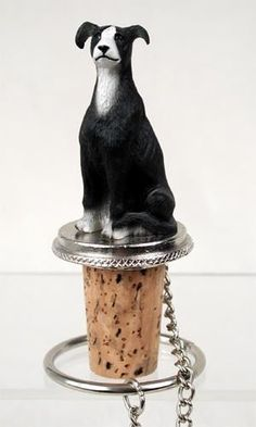 Shop for black and white Greyhound sitting on top of a unique, decorative, wine cork bottle stopper. Fits a standard size wine or champagne bottle. Wine Bottle Stoppers, Grey Hound Dog, Bar Tools, Pewter, Hand Painted, Black And White, Cool Stuff, Painting, Chain