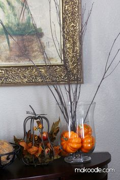 Get some baby pumpkins, collect some sticks and put them in a vase and you have a cute fall decoration.