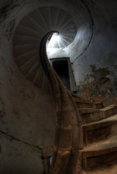 Spiral staircase at Chateau de la Source, abandoned castle in Luxemburg