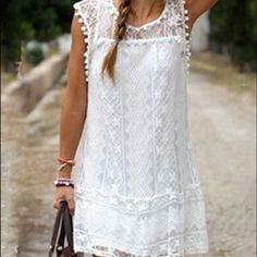 Beach coverup White Pom-Pom decorated lace beach cover up. Too see through to wear as an actual dress. Swim Coverups