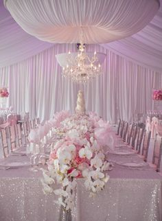 Light Pink Reception decorations WOW I love pink and silver together and the beautiful flowers,sparkly table cloth & draping makes this just spectacular.