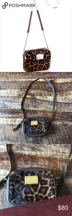 """Michael Kors Jet Set Leopard Crossbody Beautiful leopard print calf hair bag in excellent condition with no signs of wear. Inside and out is super clean. Fits my iPhone 7 no problem along with storage for cards. 6"""" across, 4.5"""" tall, 1.5"""" wide. Long leather and chain removable strap. Michael Kors Bags Crossbody Bags"""
