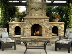 Perfect outdoor living! I love outdoor fireplaces!