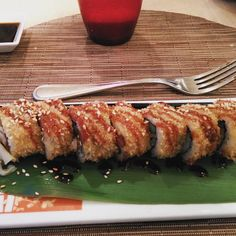 Perfect your chopsticks skills at Izumi. The Crispy Spicy Tuna roll is flash fried in panko bread and topped with unagi eel sauce and roasted sesame seeds.