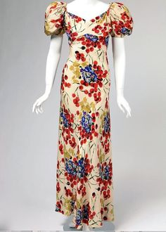 Woman's bias cut crepe evening dress with red, blue, purple & green floral print worn by Marjorie Van Evera Lovelace. Ca. 1937 | Missouri History Museum #vintage #vintagefashion