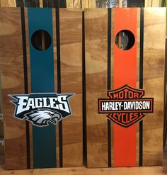 Stained Eagles and harley Davidson Custom made Corn hole Boards - These Cornhole boards are handcrafted, stained and then hand painted and custom made for each of our customers. Free set of cornhole bags are also provided for $189.99. They make great gifts for anyone for any occasion! We love custom orders and will make your team, theme or wedding.