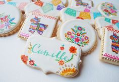 Pastry artist Sogoal Zolghadri's fiesta-inspired sugar cookies, made with almond extract and orange zest, feature vividly charming hand-painted illustrations of Mexican embroidery, papel picado bunting, and burro piñatas with rainbow fringe.