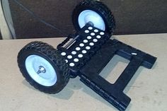 Kayak Step Cart - remove hinge, insert axle, add wheels, bottom up, add PVC and ties, load kayak and GO..