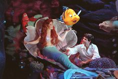 """TRUE LOVE KNOWS NO DEPTHS! Prince Eric swims to his sweetheart Ariel in """"Voyage of the Little Mermaid"""" at Disney's Hollywood Studios theme park at Walt Disney World Resort."""