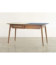 GIO PONTI Double-fronted desk, ca. 1950 Walnut, plastic laminate-covered wood, brass.