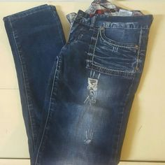 Skinny dark wash destroyed Guess jeans, size 27 Low rise, a little stretch, Guess jeans..destroyed wash super hot jeans! Sadly went up a size, now selling all my jeans..lucky you!! Xoxo Guess Jeans Skinny