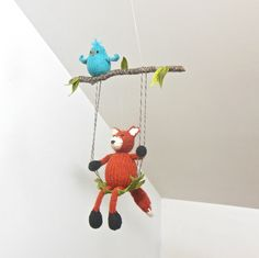 This Fox and Bird mobile is carefree and playful and will add a touch of whimsy and happiness to your babys room or playroom. The knit fox