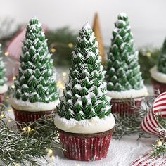 Christmas Tree Cupcakes Serve this snowy dessert this Christmas season. Cupcakes are shaped like trees, secured with snowy frosting, and sprinkled wit. Christmas Tree Cupcakes, Christmas Snacks, Xmas Food, Christmas Cooking, Noel Christmas, Christmas Goodies, Holiday Cupcakes, Christmas Cupcakes Decoration, Christmas Cookies For Kids