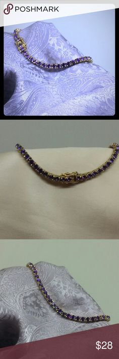 Gold Amethyst Tennis Bracelet Deep purple amethyst crystals set in gleaming yellow gold over 925 sterling silver. It measures 7.5 inches long with a locking safety catch. Very good condition 38th no missing stones. The gold shines and is not worn. Jewelry Bracelets