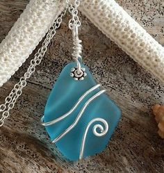 Wire wrapped sea glass necklace,925 sterling silver chain. Beach glass jewelry.                                                                                                                                                                                 More