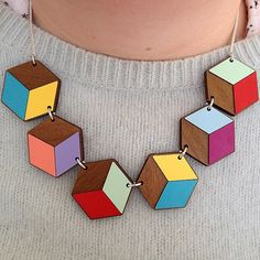 Take on AW14's geometric trend with walnut wood and Formica iometric hexadedrons: http://www.tattydevine.com/geometric-link-necklace.html