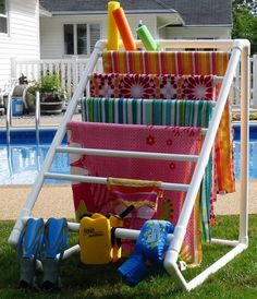 16 Awesome DIY PVC Pipe Decor Ideas for Your Home and Yard here a towel maid made with pvc pipes. or same design used inside in the laundry room or on a smaller scale for wrapping paper ( modify the crossbars by cutting a groove instead of a glued hole on one side) ...hmmm