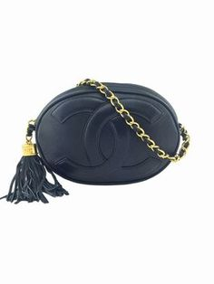 Chanel Vintage Leather Mini Oval Tassel Shoulder Bag. Get one of the hottest styles of the season! The Chanel Vintage Leather Mini Oval Tassel Shoulder Bag is a top 10 member favorite on Tradesy. Save on yours before they're sold out!