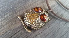 Check out this item in my Etsy shop https://www.etsy.com/au/listing/472296296/antique-bronze-owl-pendant-choker-style