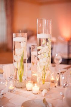 Cylinder Themed Centerpieces with Candle / http://www.deerpearlflowers.com/floating-wedding-centerpieces/