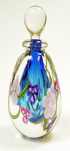 Perfume Bottle # RGA-PKBT _ Roger Gandelman's blue centered bottle surrounded by delicate flowers encased in clear crystal. This perfume bottle stands tall. Perfumes Vintage, Antique Perfume Bottles, Vintage Bottles, Bottle Vase, Glass Bottles, Wine Bottles, Glass Vase, Glas Art, Beautiful Perfume